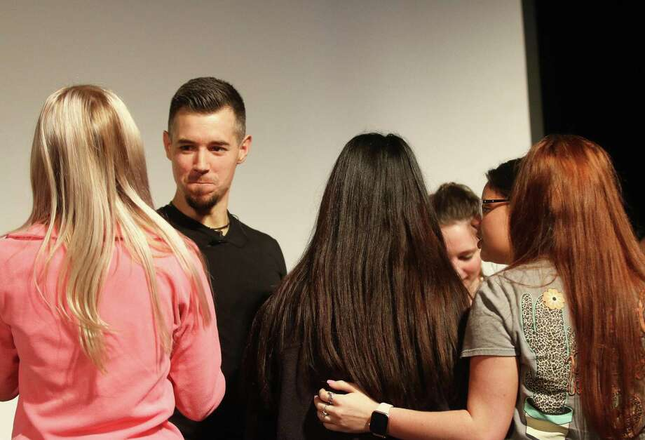 The former teacher was swarmed by his former students following his presentation. He says he will continue down the path he believes is his destiny and do his best to help others. Photo: David Taylor / Staff Photo