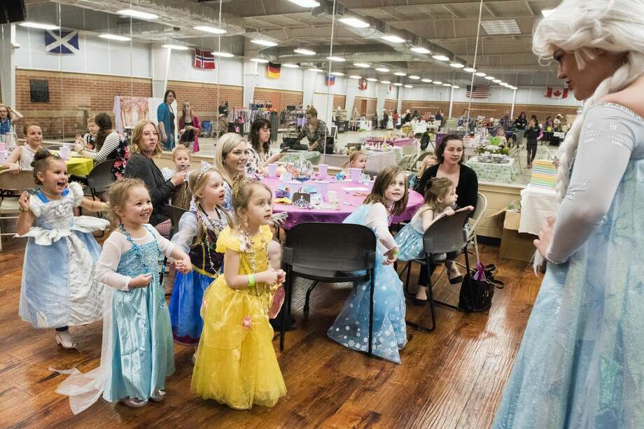 "Girls dressed as princesses react to meeting ""Queen Elsa"" from Disney's Frozen during a Mothers and Daughters Tea Party at the Midland Curling Club on Saturday. (Danielle McGrew Tenbusch/for the Daily News) Photo: Danielle McGrew Tenbusch"