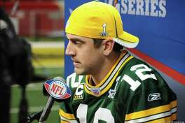 Green Bay Packers quarterback Aaron Rodgers answers questions during a media day earlier this decade.
