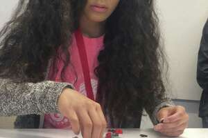 Girl Scout Atziry Juarez took part in Toyota's LEGO car team-building exercise. (Photo courtesy of Toyota)