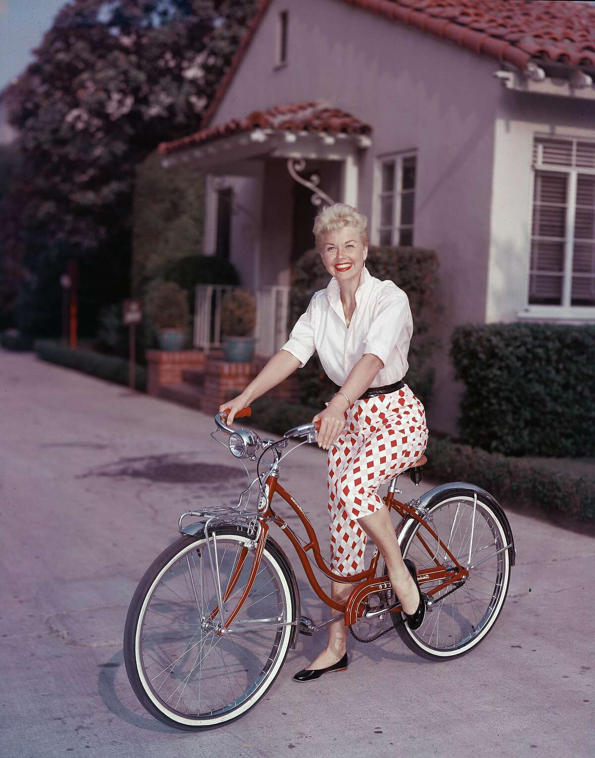 it has been announced that actress Doris Day has died at the age of 97 on May 13, 2019. American actor Doris Day poses on a red Schwinn bicycle, late 1950s. (Photo by Hulton Archive/Getty Images)