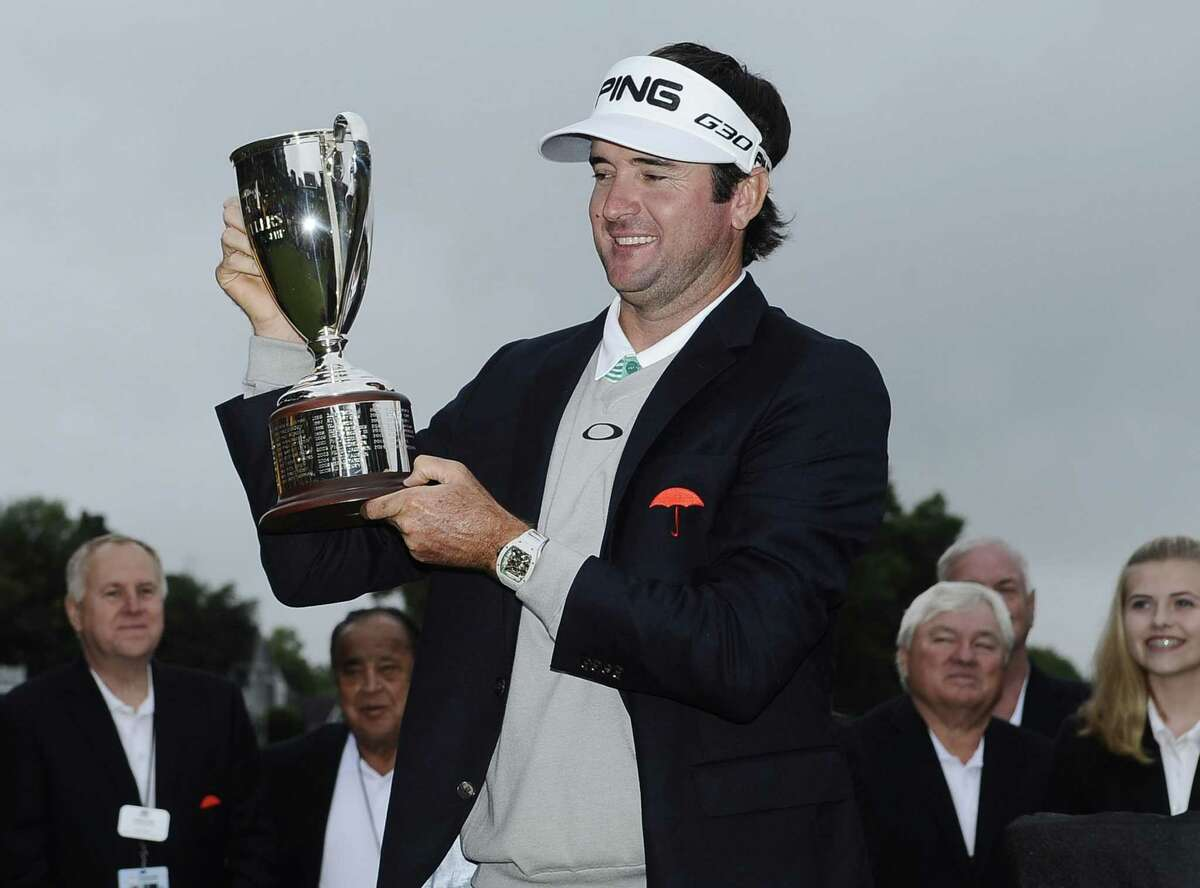 Bubba Watson holds the championship trophy after winning the Travelers Championship Sunday, June 28, 2015, in Cromwell. Watson beat out Paul Casey in a playoff