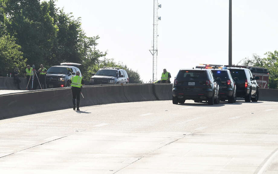 Beaumont Police investigate a fatal accident involving a motorcycle rider on interstate 10 near Magnolia Monday morning. Photo taken Monday, 5/13/19 Photo: Guiseppe Barranco/The Enterprise / Guiseppe Barranco ?
