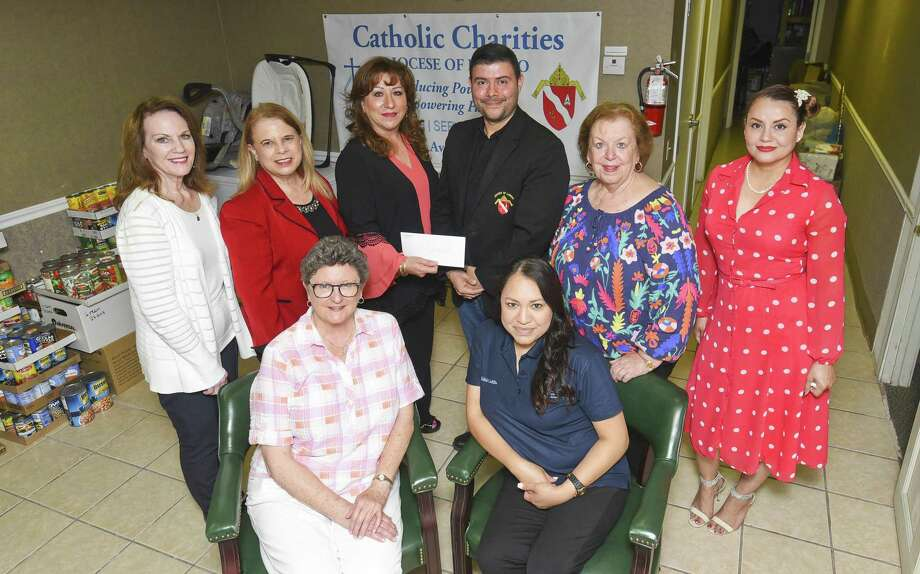 The Women's City Club gathers at Laredo Catholic Charities to present a check to the organization on Wednesday. Photo: Danny Zaragoza /Laredo Morning Times / Laredo Morning Times