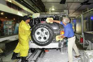 Splash Car Wash CEO Mark Curtis, right, works at the Splash car wash at 625 W. Putnam Ave. in Greenwich, Conn., on July 22, 2015. Splash has announced the acquisition of a car wash in Middletown, N.Y.