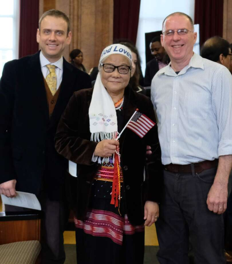 Apee Me Redith celebrates getting her naturalization with Jacob Slutzky, USCRI Services to Older Refugees Program (SORP) program coordinator, left and her tutor USCRI volunteer Dino Mirabito, right at the James Foley Federal Courthouse in Albany, N.Y. on April 12, 2019. Photo: Courtesy Of USCRI