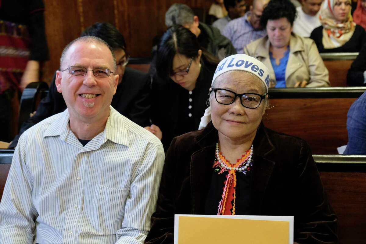 Apee Me Redith celebrates getting her naturalization with her tutor USCRI volunteer Dino Mirabito, right at the James Foley Federal Courthouse in Albany, N.Y. on April 12, 2019.