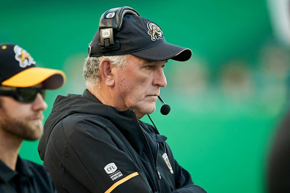 PHOTOS: June Jones through the years REGINA, SK - JULY 05: Head coach June Jones of the Hamilton Tiger-Cats on the sideline during the game between the Hamilton Tiger-Cats and Saskatchewan Roughriders at Mosaic Stadium on July 5, 2018 in Regina, Canada. (Photo by Brent Just/Getty Images)