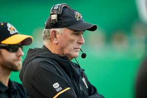 REGINA, SK - JULY 05: Head coach June Jones of the Hamilton Tiger-Cats on the sideline during the game between the Hamilton Tiger-Cats and Saskatchewan Roughriders at Mosaic Stadium on July 5, 2018 in Regina, Canada. (Photo by Brent Just/Getty Images)