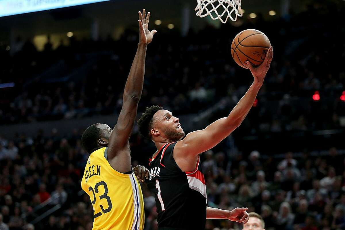 PORTLAND, OR - FEBRUARY 13: Evan Turner #1 of the Portland Trail Blazers takes a shot against Draymond Green #23 of the Golden State Warriors in the first half during their game at Moda Center on February 13, 2019 in Portland, Oregon. NOTE TO USER: User e