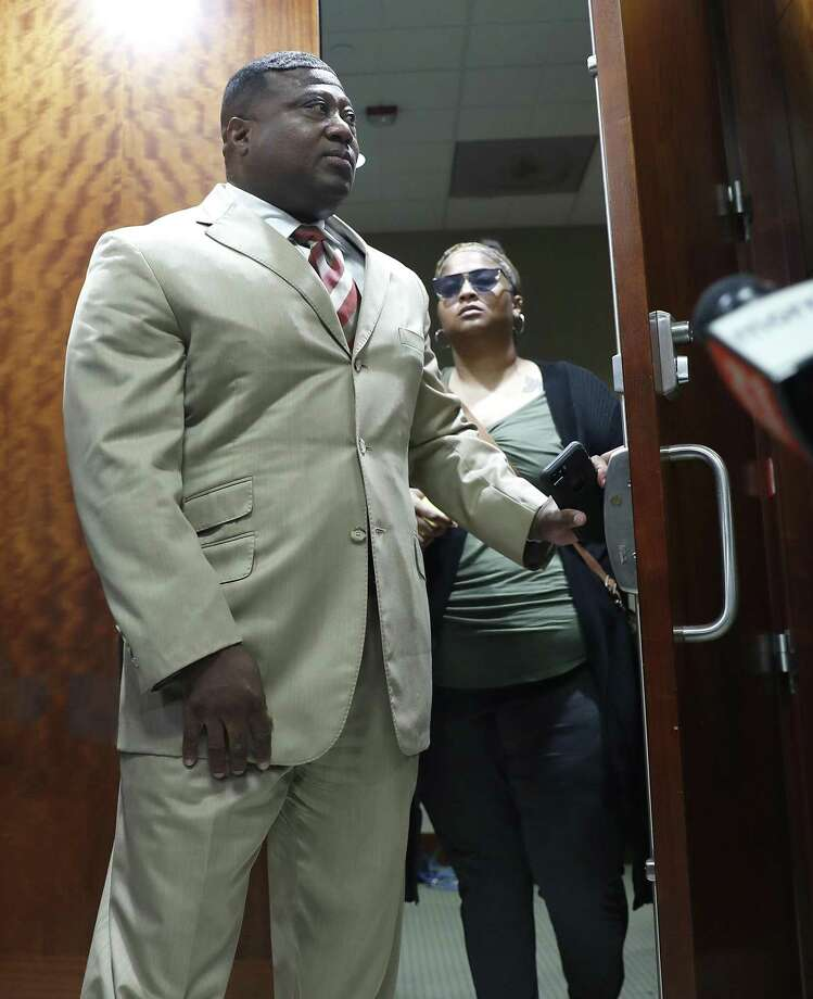 Quanell X walks out of the courtroom with Brittany Bowens, the mother of the missing 4-year-old, Maleah Davis after the court postponed a court appearance for Derion Vence, who is charged with tampering with evidence in the case of Maleah Davis' disappearance, Monday, May 13, 2019, in Houston. Photo: Karen Warren, Houston Chronicle / Staff Photographer / © 2019 Houston Chronicle