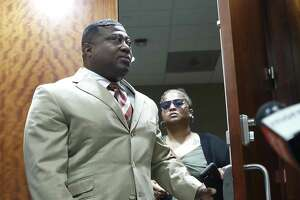Quanell X walks out of the courtroom with Brittany Bowens, the mother of the missing 4-year-old, Maleah Davis after the court postponed a court appearance for Derion Vence, who is charged with tampering with evidence in the case of Maleah Davis' disappearance, Monday, May 13, 2019, in Houston.