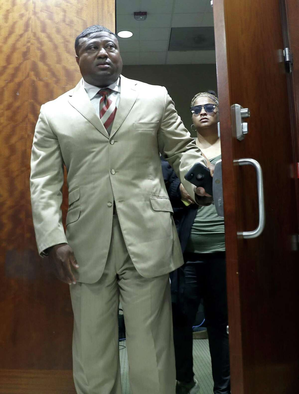Quanell X walks out of the courtroom with Brittany Bowens, the mother of the missing 4-year-old, Maleah Davis after the court postponed a court appearance for Derion Vence, who is charged with tampering with evidence in the case of Maleah Davis' disappearance, Monday, May 13, 2019, in Houston. >>> Click through for a timeline of the case