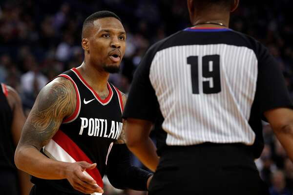 676eeb9c984 1of3Damian Lillard (0) speaks to a referee after being called for a foul  during the second half as the Golden State Warriors played the Portland  Trail ...