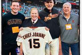 Sean White (left) with his mom, Ret. SFFD Chief Joanne Hayes-White, Giants Skipper Bruce Bochy and his uncle, Danny Hayes. May 1, 2019.