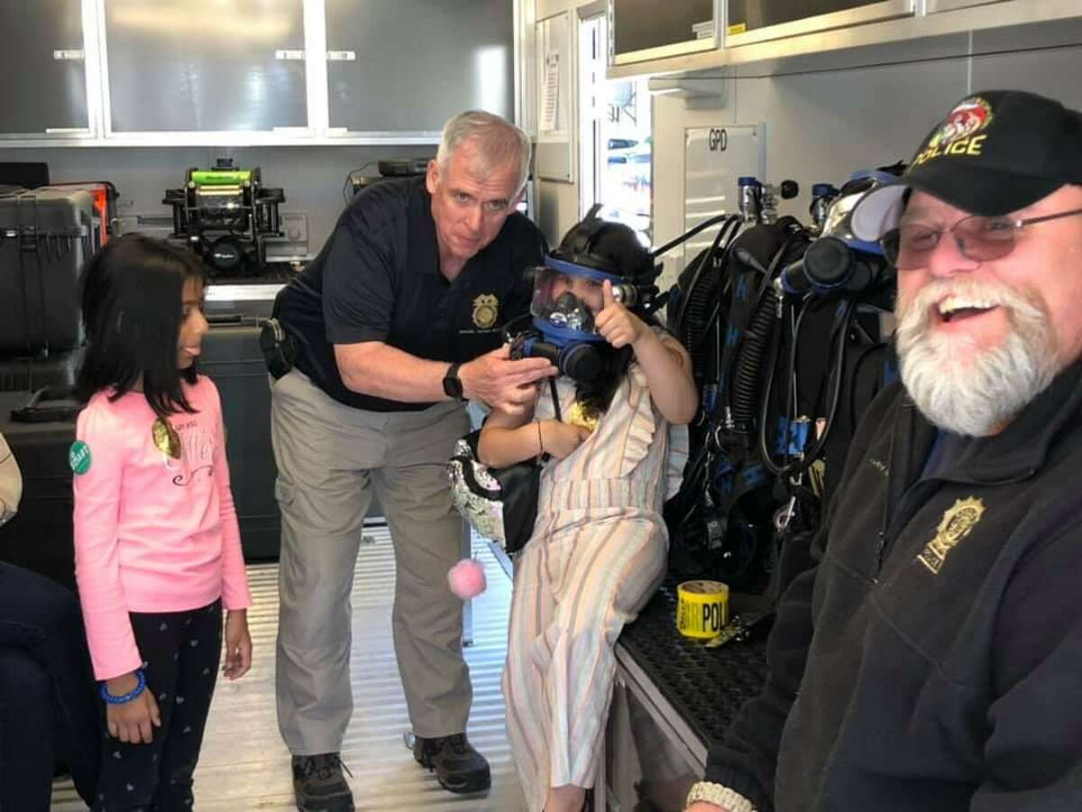 Chief Heavey and Officer Fox show off diving gear.