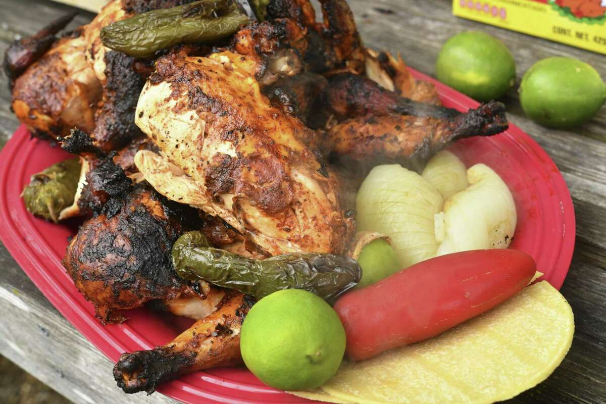 A finished plate of pollo asado, a Northern Mexico-style grilled chicken, marinated in a mixture consisting of achiote paste, lime juice, orange juice, kosher salt, soy sauce, Worcestershire sauce and black pepper.
