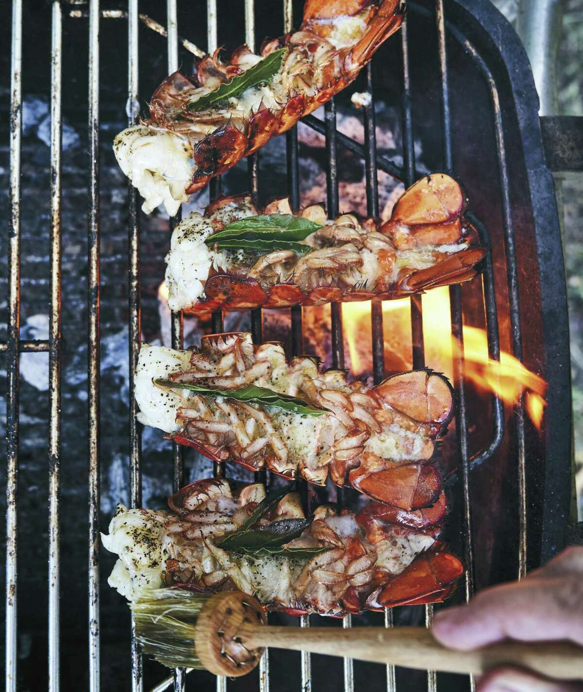 """Smoky Lobster Tails from""""Thank You for Smoking: Fun and Fearless Recipes Cooked with a Whiff of Wood Fire on Your Grill or Smoker"""" by Paula Disbrowe (Ten Speed Press, $30)."""