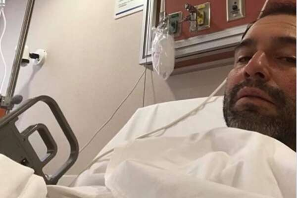 "Last Wednesday, the 46-year-old posted a photo from a hospital bed. No additional information was provided, aside from an emoji depicting an illness. Fans of the ""Desvelado"" singer quickly replied with well wishes and prayers. Some asked what caused the hospital stay."