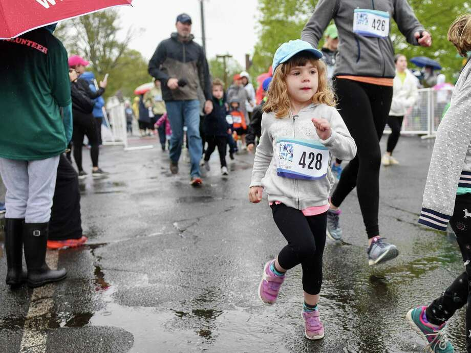 The 12th annual Run Like a Mother 5K took place on a rainy Mother's Day on Sunday, May 23, 2019. The event was originally started by Ridgefield resident Megan Searfoss. Photo: Bryan Haeffele // Bryanhaeffele.com / Hearst Connecticut Media / BryanHaeffele