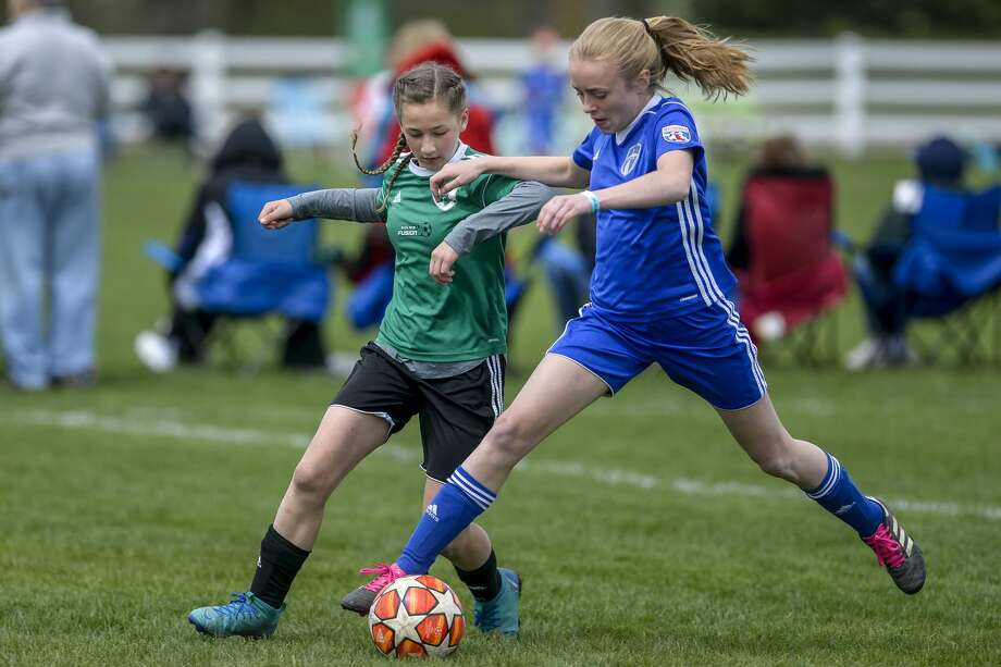 Midland Fusion 06's Ila Tomko attempts to get the ball during their game against La Forza 06 Blue during the 37th annual Midland Invitational Tournament at the Midland Soccer Club in Midland on Saturday, May 11, 2019. (Josie Norris/for the Daily News) Photo: Josie Norris/Midland Daily News, (Josie Norris/for The Daily News)