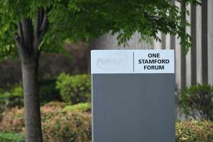 Purdue Pharma-branded signs have been taken down outside Purdue Pharma's headquarters at 201 Tresser Blvd. in downtown Stamford, Conn. This street marker still has the tracing of the company's logo.