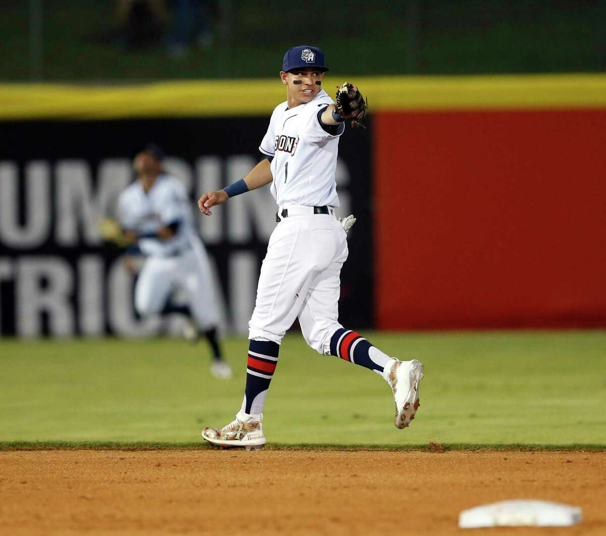 Muricio Dubon motions to a teammate to cover second as he positions himself to take the cut-off as the San Antonio Missions hosted the Round Rock Express on Friday, April 3, 2019, at Wolff Stadium.