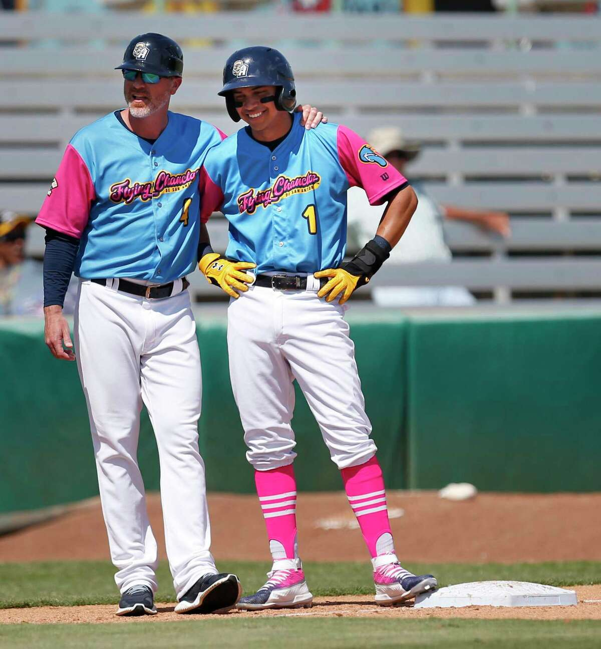 Mauricio Dubon talks with coach Ned Yost IV during game against the Round Rock Express as the San Antonio Missions hosted the Round Rock Express on Sunday, April 5, 2019, at Wolff Stadium.