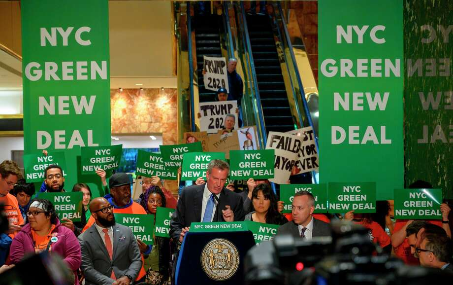 New York City Mayor Bill de Blasio speaks inside Trump Tower about the Green New Deal, serving notice to US President Donald Trump demanding more energy-efficient buildings, including Trump Tower, May 13, 2019 in New York. Photo: DON EMMERT/AFP/Getty Images