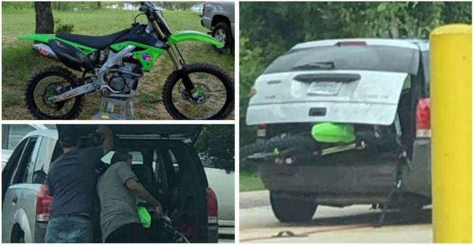 People in a Spring HEB parking lot photographed two men putting a dirt bike into the back of their vehicle, allegedly stealing it from another man who was inside shopping. Photo: Courtesy Of The Montgomery County Sheriff's Office