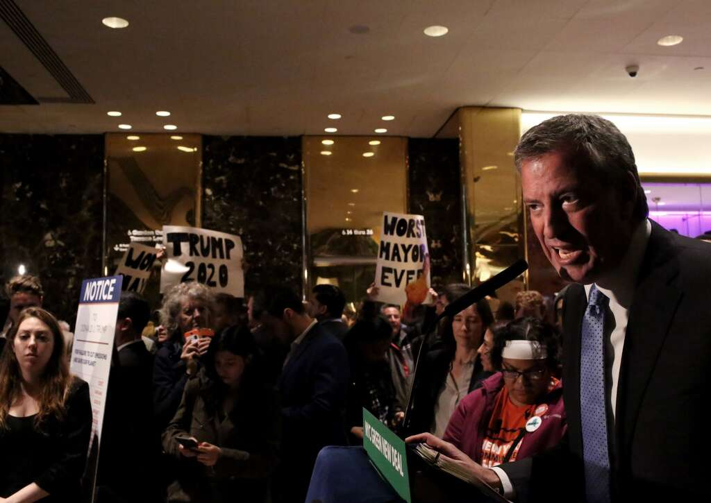 <p>Protesters gather as Mayor Bill De Blasio holds a Green New Deal rally At Trump Tower in New York City on May 13, 2019. Mayor de Blasio recently unveiled his Green New Deal to reduce carbon emissions in New</p>