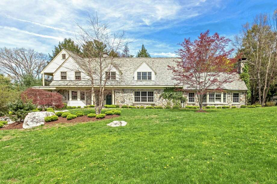 The custom shingle and stone colonial house at 9 Brookside Drive sits in a private setting on a quiet In-town cul-de-sac only a mile from downtown Westport.