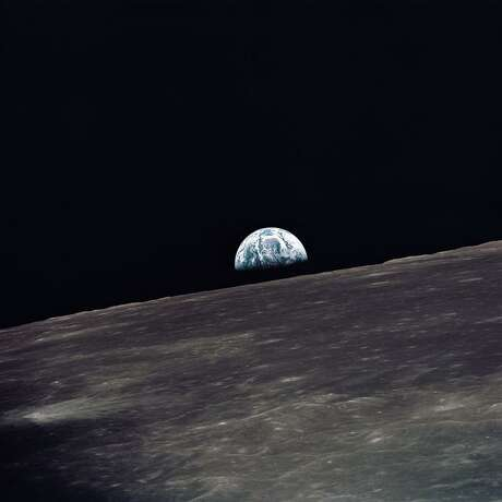 (18-26 May 1969) --- A view of Earth rising above the lunar horizon photographed from the Apollo 10 Lunar Module, looking west in the direction of travel. The Lunar Module at the time the picture was taken was located above the lunar farside highlands at approximately 105 degrees east longitude.