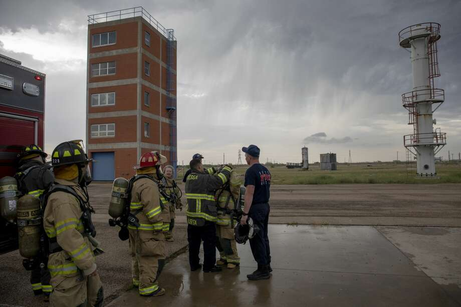 Students of the Citizens Fire Academy experience a live burn on May 7 at the Odessa Fire Rescue training facilities. Photo: Jacy Lewis/191 News