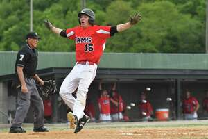 Cheshire's Ryan Strollo celebrates scoring against Fairfield Prep during a Class LL semifinal June 6.