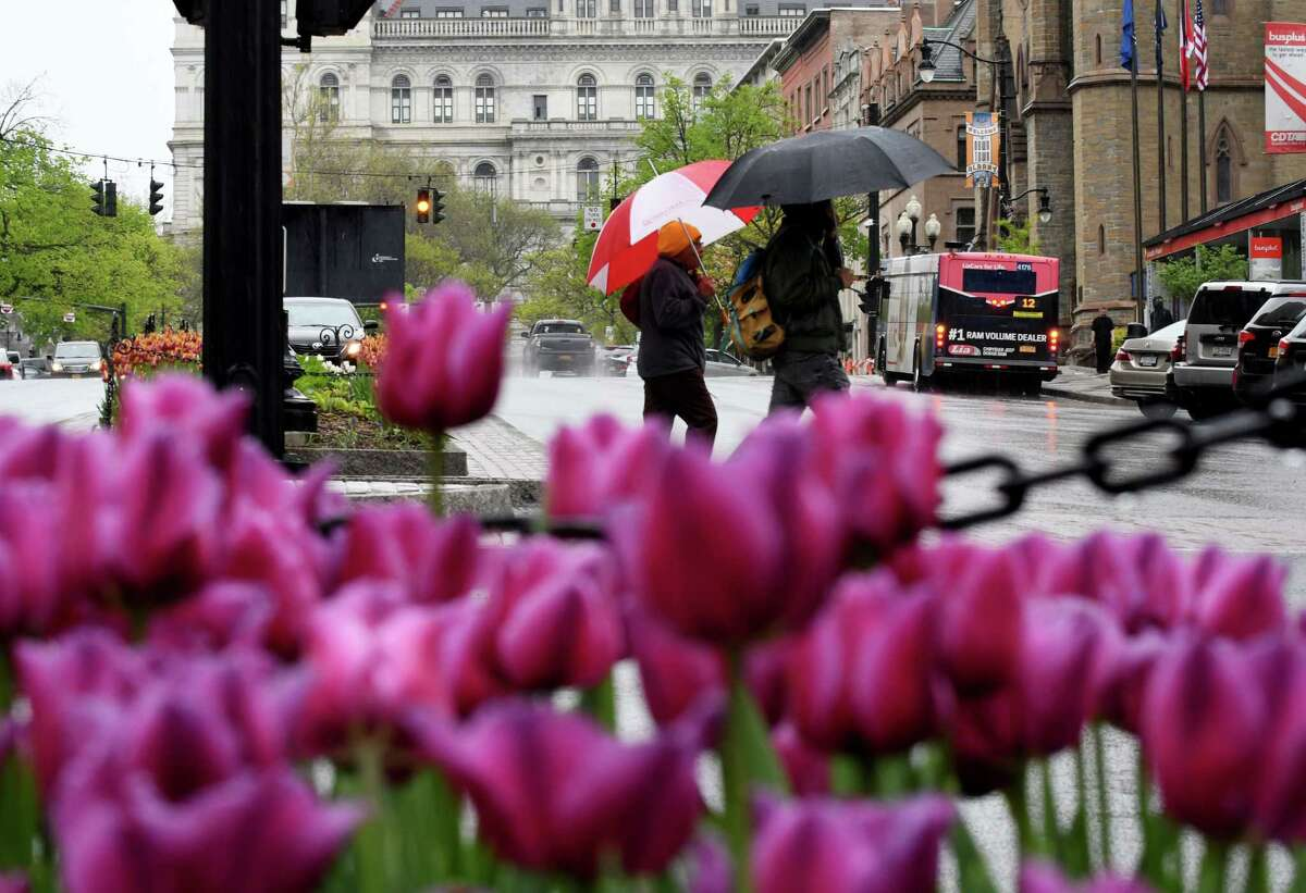A steady downpour of rain falls along State Street at Pearl on Monday afternoon, May 13, 2019, in Albany, N.Y. (Will Waldron/Times Union)