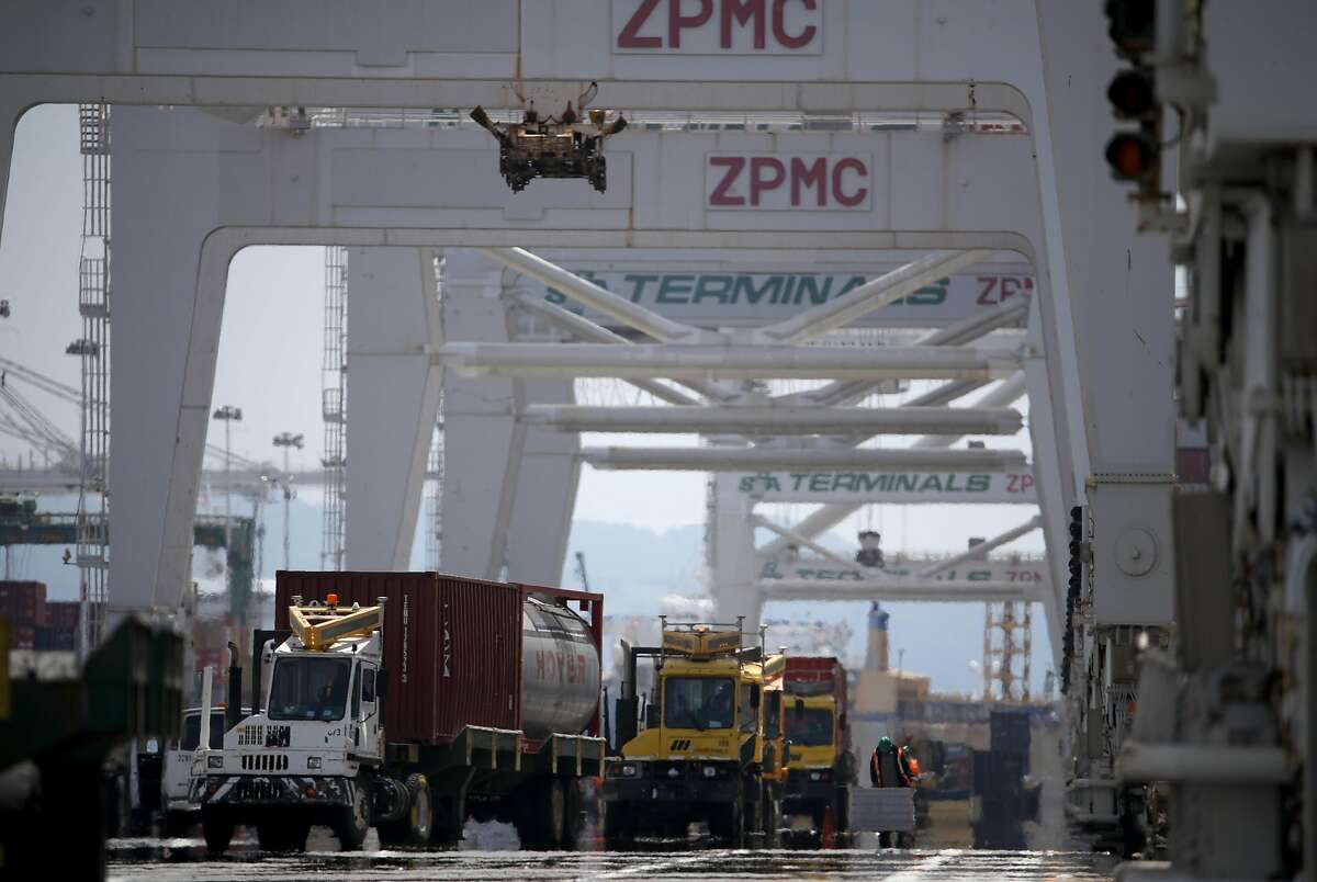 OAKLAND, CALIFORNIA - MAY 13: Containers are offloaded from a ship docked at the Port of Oakland on May 13, 2019 in Oakland, California. China retaliated to U.S. President Donald Trump's 25 percent tariffs on $250 billion of Chinese goods entering the United States with a 25 percent tariff on $60 billion of U.S. goods entering China. The Dow Jones Industrial Average plunged over 700 points on the news in morning trading. (Photo by Justin Sullivan/Getty Images)