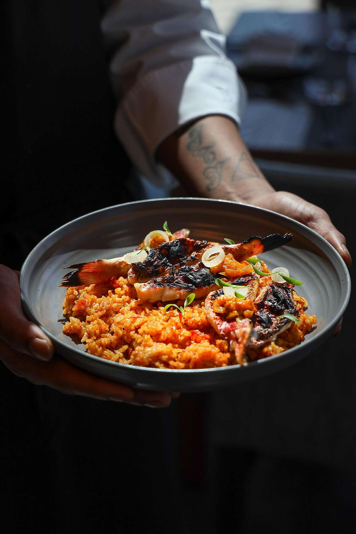 Crab Jollof Rice with Rouget at Kith and Kin in Washington, April 1, 2019. Chef Kwame Onwuachi vaulted from troubled youth to overnight success to failure with a fancy restaurant in Washington, D.C. Now he's drawing attention with a new book and approach. (Jennifer Chase/The New York Times)