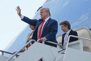 President Donald Trump stops to wave as he steps off Air Force One with first lady Melania Trump and their son Barron Trump. Trump radio will soon be coming to Hartford.