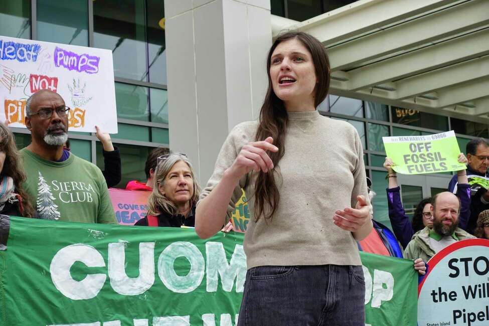 Lee Ziesche, with Sane Energy Project, addresses those gathered for a rally outside the Capital Center on Monday, May 13, 2019, in Albany, N.Y. National Grid was holding a forum inside the center to highlight its pledge to cut 80% of its emissions by 2050. (Paul Buckowski/Times Union)