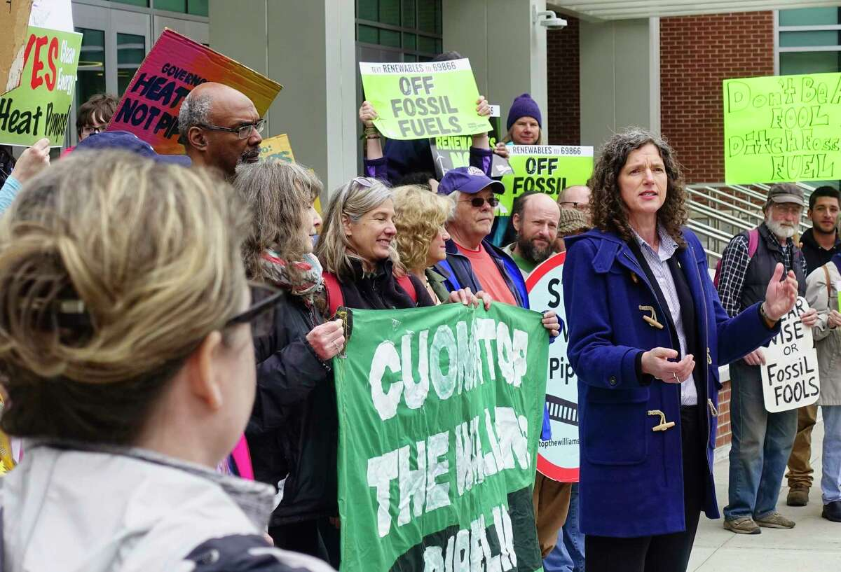 Then-state Senator Jen Metzger addresses those gathered for a rally outside the Capital Center on Monday, May 13, 2019, in Albany, N.Y. National Grid was holding a forum inside the center to highlight its pledge to cut 80% of its emissions by 2050. (Paul Buckowski/Times Union)
