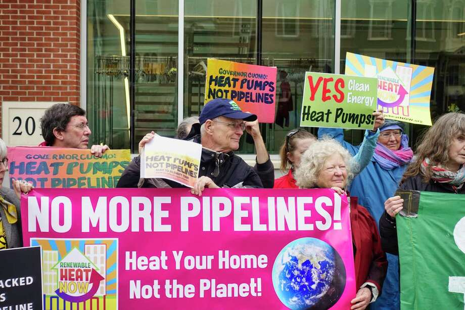 Members of the groups Mothers Out Front, Renewable Heat Now Campaign and Stop the Williams Pipeline Coalition take part in a rally outside the Capital Center on Monday, May 13, 2019, in Albany, N.Y. National Grid was holding a forum inside the center to highlight its pledge to cut 80% of its emissions by 2050.   (Paul Buckowski/Times Union) Photo: Paul Buckowski, Albany Times Union / (Paul Buckowski/Times Union)