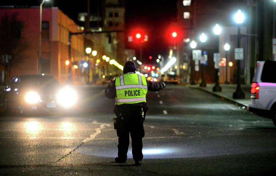 A Bridgeport Police Officer directs traffic for a Sound Tigers hockey game at the Webster Bank Arena in Bridgeport, Conn., on Friday Jan. 27, 2017. Photo: Christian Abraham / Hearst Connecticut Media / Connecticut Post