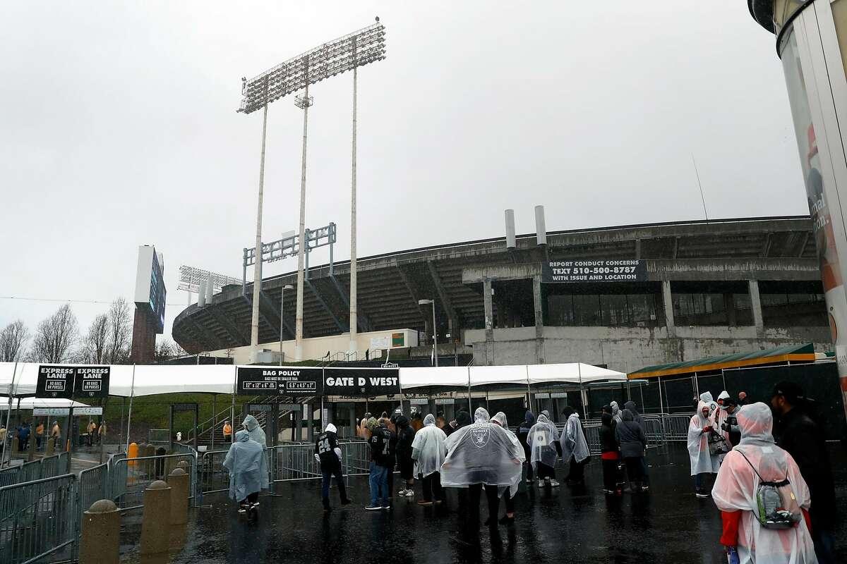 Fans wait to enter Oakland Raiders' NFL game against Denver Broncos at Oakland Coliseum in Oakland, Calif. on Monday, December 24, 2018.