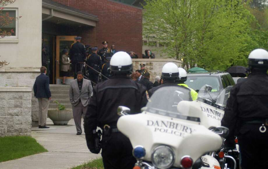 George Johnson, a retired Danbury Police Department captain, was buried with full honors Monday, May 13, 2019, including police escort from the New Hope Baptist Church to Wooster Cemetery in Danbury. Photo: Rob Ryser / Hearst Connecticut Media