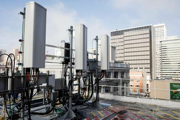 Three antennas sit on the radio access network hardware of AT&T's 5G network base station on top of the historic Argonaut Building in the Financial District of San Francisco, Calif. Thursday, Jan. 10, 2019.