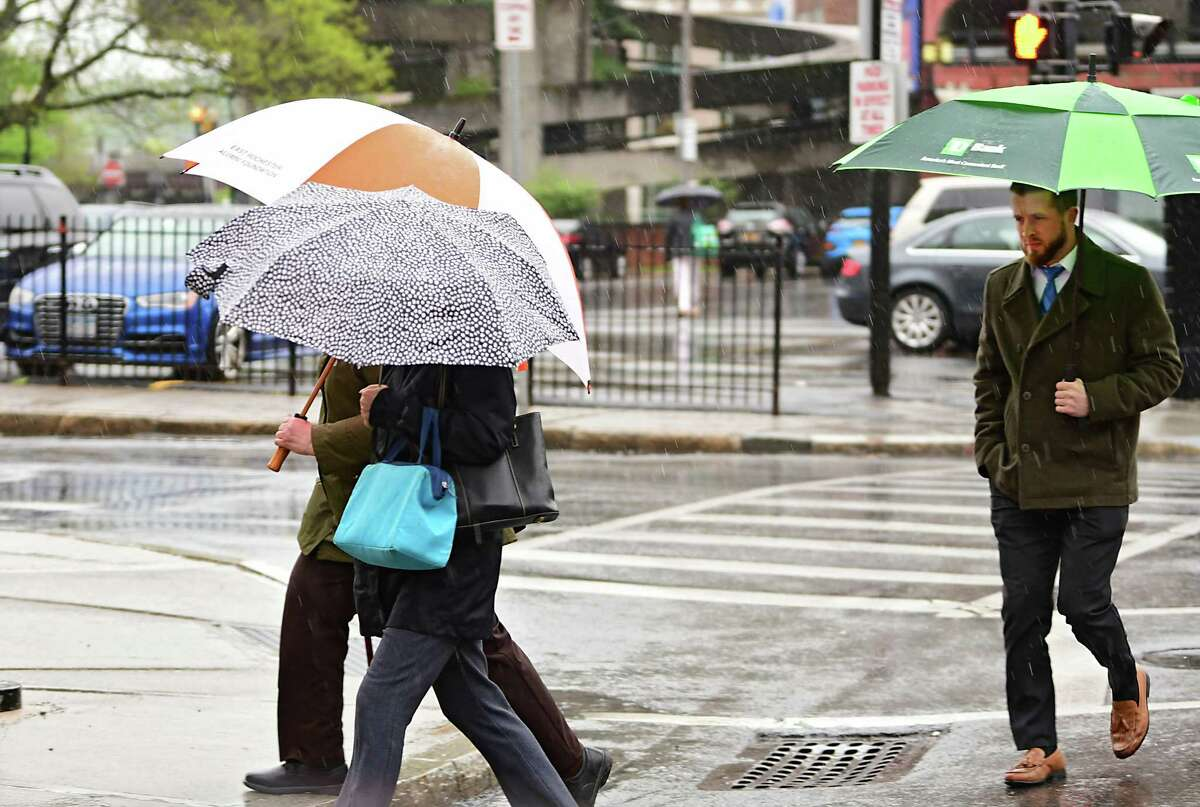 Pedestrians use umbrellas to stay dry along Sheridan Ave. during a steady rain on Monday, May 13, 2019 in Albany, N.Y. (Lori Van Buren/Times Union)