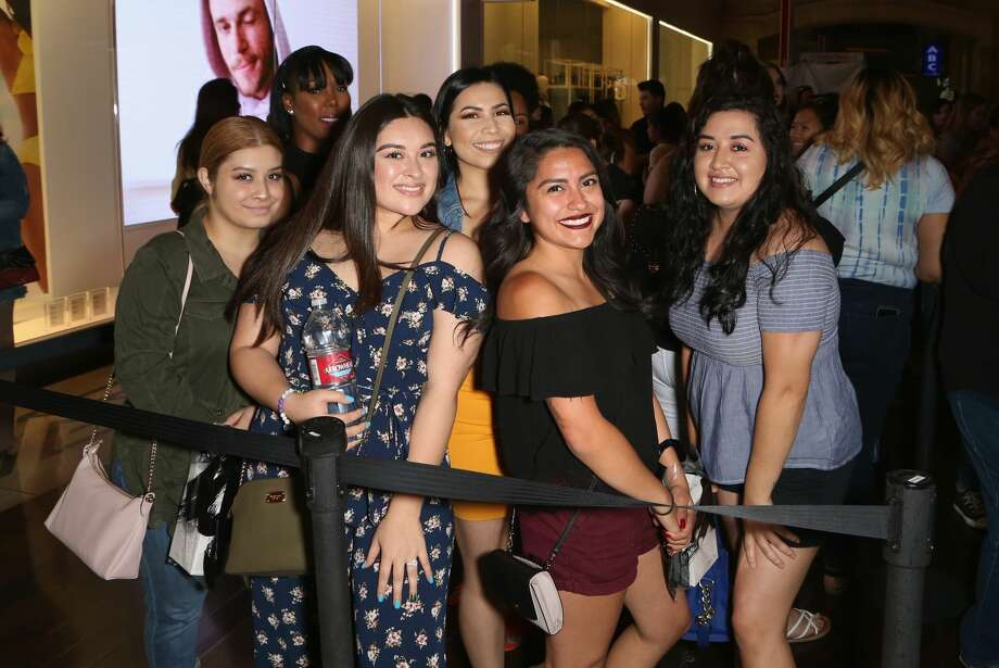 Customers pose during a Morphe store opening at the Miracle Mile Shops at Planet Hollywood Resort & Casino on June 16, 2018, in Las Vegas. Photo: Gabe Ginsberg/Getty Images For Morphe