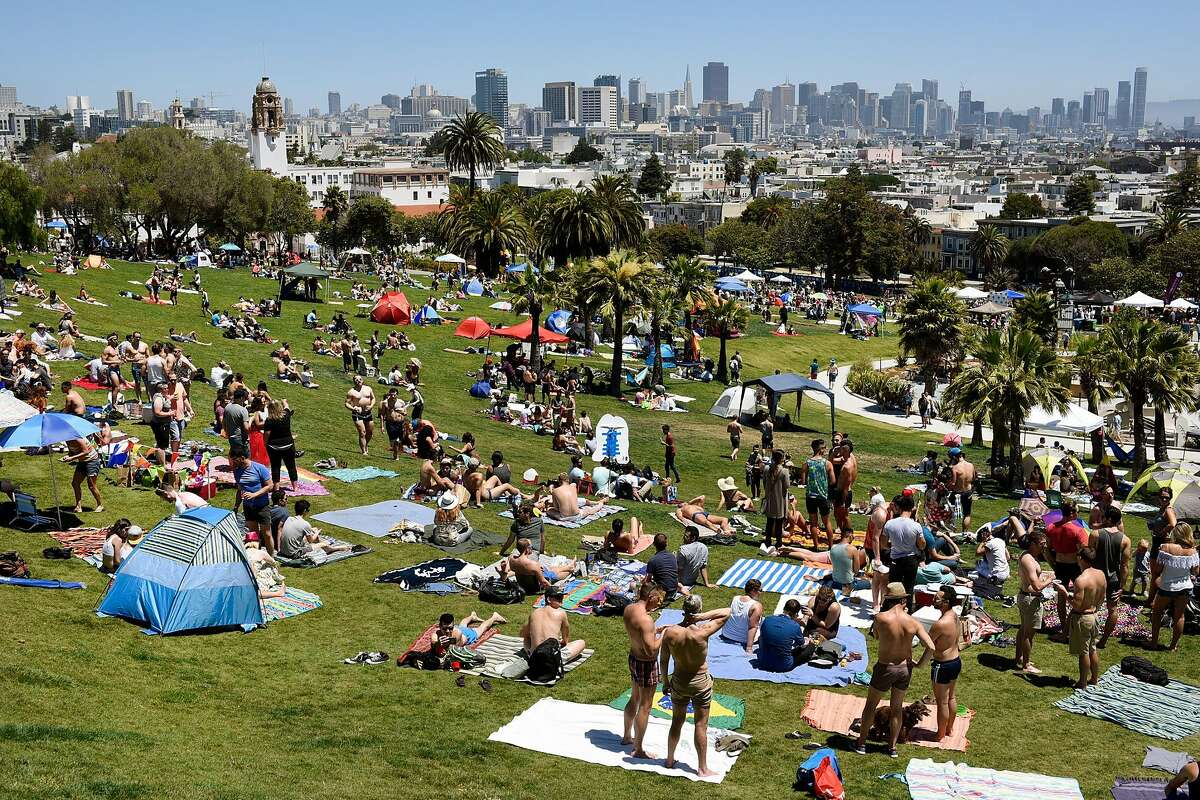 Crowds of people pack into the park during the San Francisco Dyke March rally at Dolores Park in San Francisco, CA Saturday, June 25, 2016.