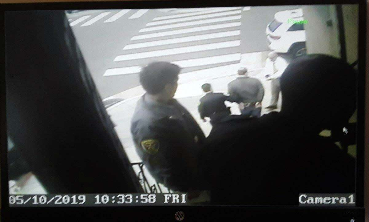 Security video shows San Francisco police taking journalist Bryan Carmody into custody on May 10, 2019.